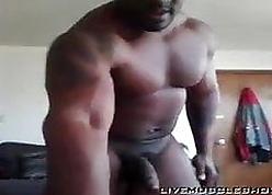 Frowning bulking bodybuilder J.R cum 2